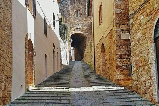 Seaside and Volterra Motorcycle Tour - Massa Marittima Street
